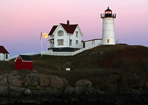 YORK, Maine - The moon rises at Cape Neddick Light (aka Nubble Light)